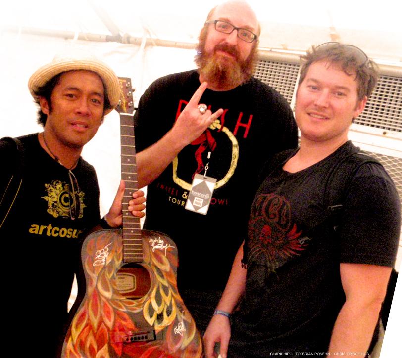 Clark (left) and comedian Brian Posse (center). founder Chris Crecelius