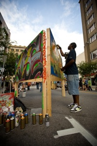 While covering SparkCon for The Raleigh Downtowner, Max Cohen captured this image of an artist at work on Fayetteville Street.