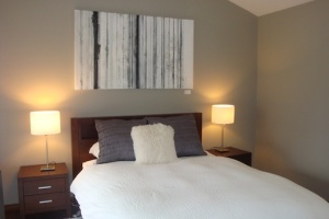 """The master bedroom. Art work above the bed: """"Amadeus"""" by Constance Pappalardo. Photo by Sarah Sonke, AuctionFirst®"""